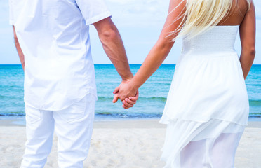 Loving couple walking and embracing on the beach