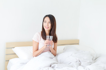 Young asian women drinking a glass of water