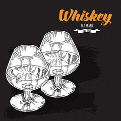 Whiskey drink. Hand drawn two glasses of whiskey. Engraving styl