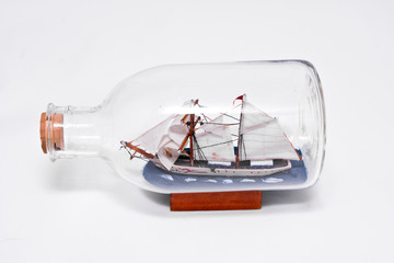 ship in a bottle on a white background