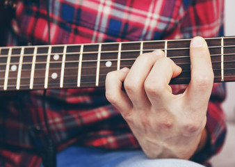 Man with guitar closeup