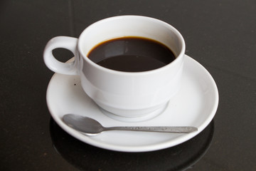 espreso black coffee in white cup on black table