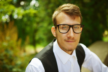 young hipster boy with glasses