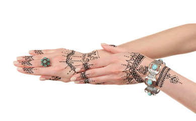 Henna tattoo on female hands isolated on white