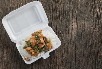 Crispy pork with Basil fried rice in foam box