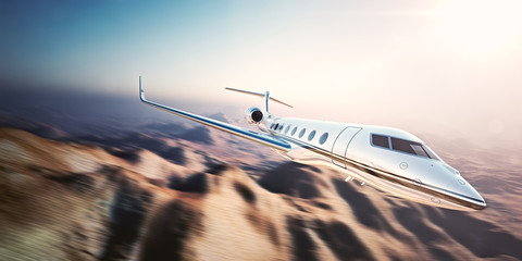 Image of white modern and luxury generic design private jet flying in blue sky at sunrise.Uninhabited desert mountains background.Business travel picture.Horizontal,motion blurred effect.3d rendering