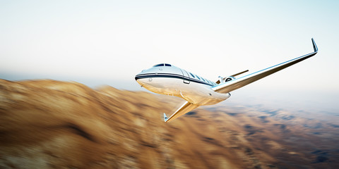 Image of white modern and luxury generic design private jet flying in blue sky over earth.Uninhabited desert mountains background.Business travel picture.Horizontal,motion blurred effect.3d rendering