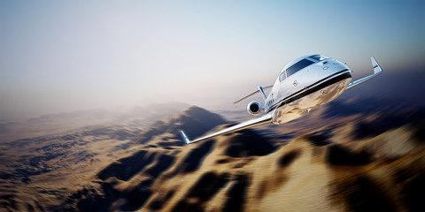 Picture of white modern and luxury generic design private jet flying in blue sky over earth.Uninhabited desert mountain background.Business travel picture.Horizontal,motion blurred effect.3d rendering