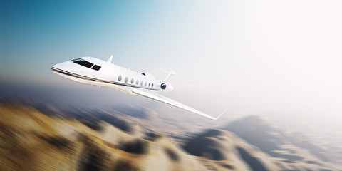 Image of white modern and luxury generic design private jet flying at sunrise over uninhabited desert.Mountains background.Business travel concept. Horizontal,motion blurred effect. 3d rendering