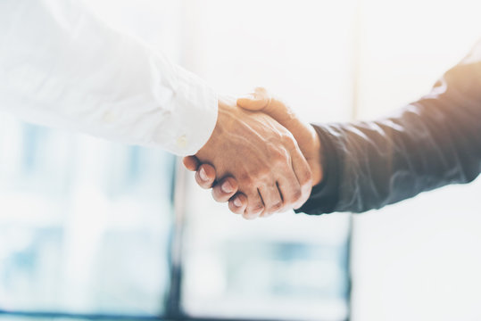 Business partnership meeting. Picture businessmans handshake. Successful businessmen handshaking after good deal. Horizontal, blurred background