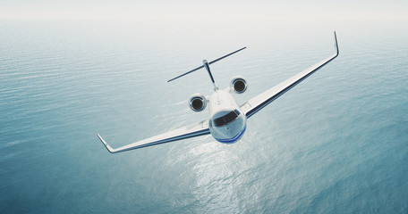 Photo of white luxury generic design private jet flying over the empty sea. Blue sky at background.Business travel concept. Horizontal . 3d rendering