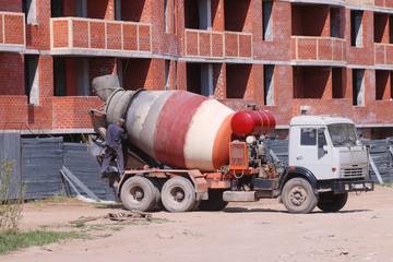 PERM, RUSSIA - MAY 15, 2015: Concrete mixer near building
