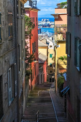Narrow steep alley in the city center of Genoa