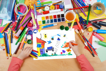 jumping car, animals and home having fun, child drawing , top view hands with pencil painting picture on paper, artwork workplace