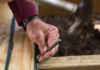 Carpenter using nail punch