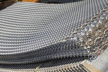 Steel slotted plate. Metal notched sheet. Hot-rolled flat steel. Metal slotted leaf. Rusty ferrum. Steel punched plates.