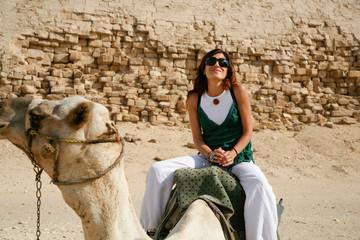 woman riding camel