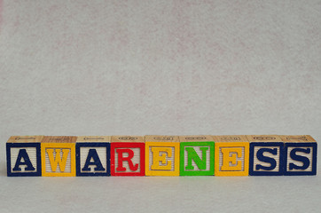 The word awareness spelled with colorful alphabet blocks isolated on white background