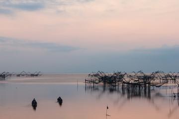 Silhouette of big fish net trap