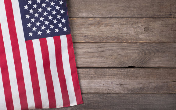 United States Flag on Wooden Background with Copy Space