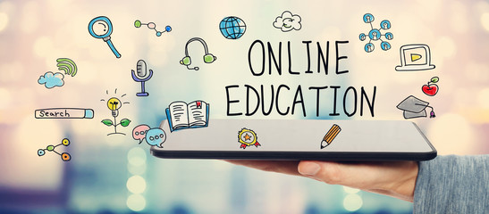 Online Education concept with man holding tablet