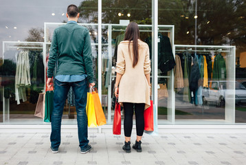Man and woman in front of the store window