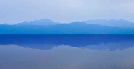 Canvas Prints Reflection group of blue mountain layers with water reflection in Thailand