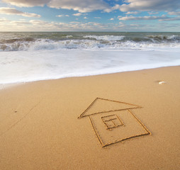 Sea and home on the sea sand