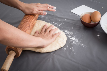 Female hands baking dough