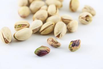 Pistachois nuts on white background.