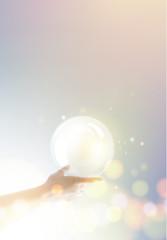 Bright light ball over human hand.