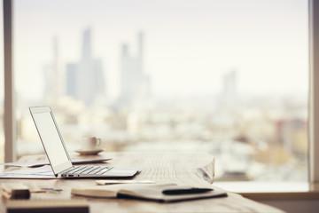 Office desktop on city background Fotomurales