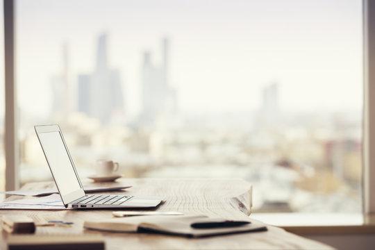 Office desktop on city background