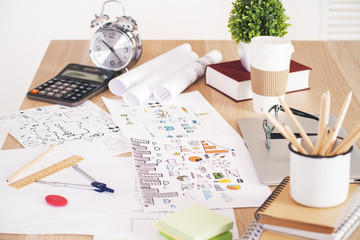 Wooden desktop with business sketches