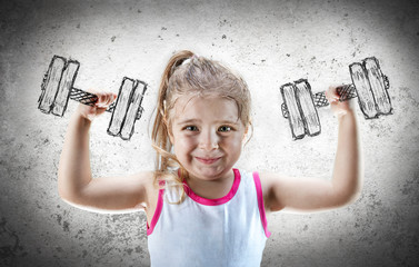 Strong Child - Little Girl Raises Dumbbell Drawn On The Wall