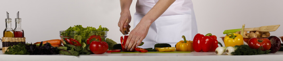 Foto op Textielframe Koken cooking diet meal mixed salad. hands cut vegetables