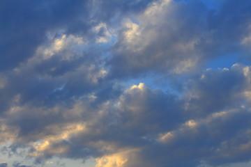 Blue, beautiful sky with  orange, grey, blue clouds