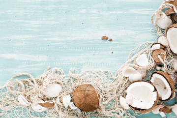 summer background with fishing net and coconuts.