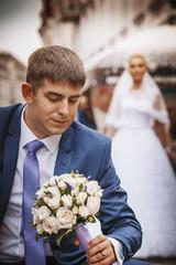 groom bride hold wedding bouquet, in his hand.