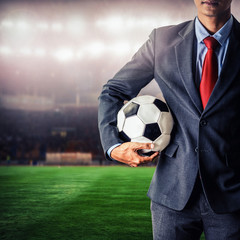 soccer manager holding football in the stadium,closeup color process