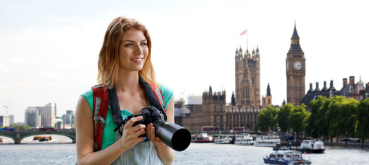 woman with backpack and camera over london big ben