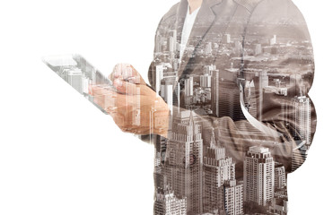 dDouble exposure of a businessman and a city using a tablet over