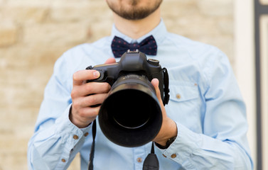 close up of male photographer with digital camera