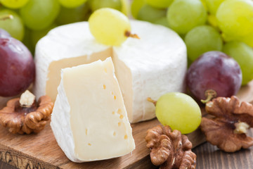fresh camembert, walnuts and fresh grapes, selective focus