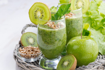 healthy green smoothie with sprouts on a white wooden table
