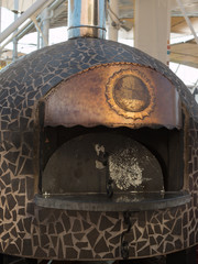 Closed Wood-burning Oven with Copper Sign