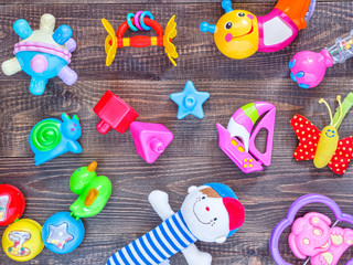 top view or flat lay on colorful toys on dark wooden background