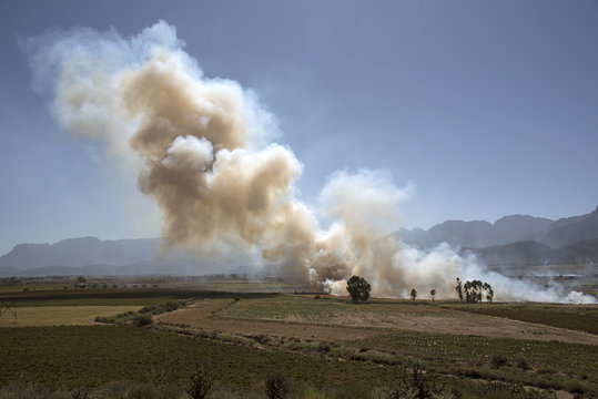 Burning off old crops from farmland in the Western Cape South Africa