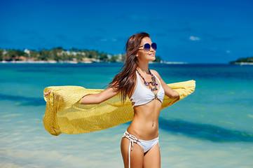 Beautiful pretty woman in bikini on tropical paradise beach