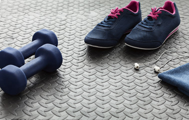 Sneakers and dumbbells